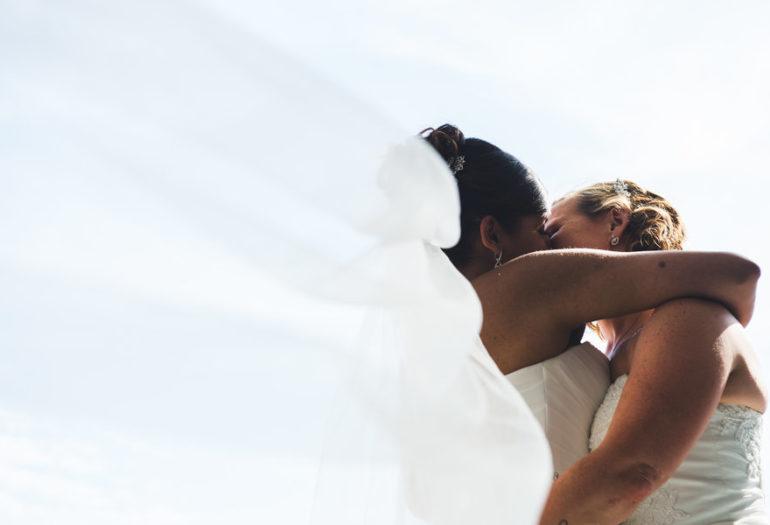 Brides kissing on wedding day