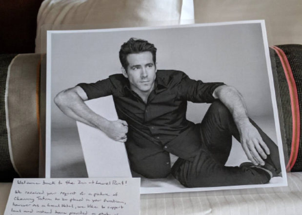 black and white photo of actor Ryan Reynolds on bed with handwritten note