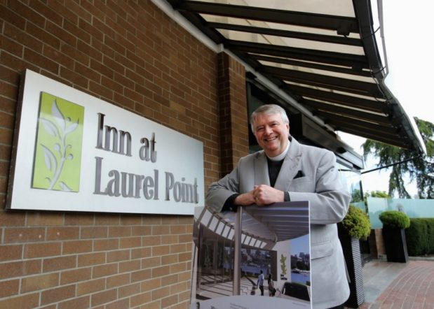 Ian Powell standing outsode of Inn at Laurel Point Hotel Victoria BC